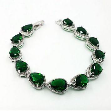 Серебряный с зеленым камнем