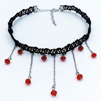 Черный с красный камнем