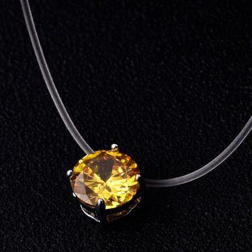 Серебряный с желтым камнем