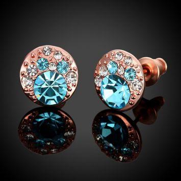 Розовое золото с голубым камнем