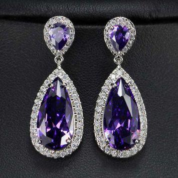 Серебряный с фиолетовым камнем