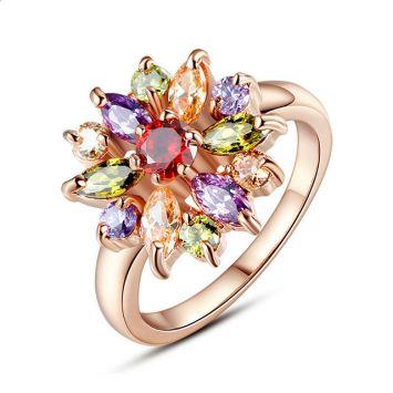 Розовое золото с разноцветным камнем